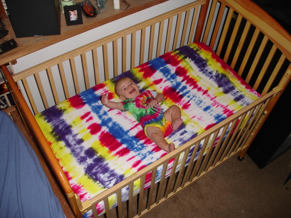 Laughing in his Crib